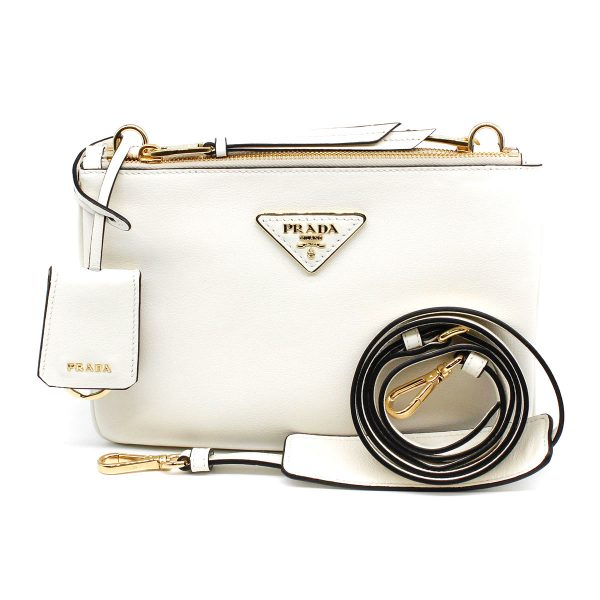 prada white bag front with gold hardware with leather strap