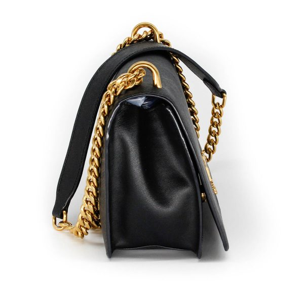 prada flap bag in black with gold chain side