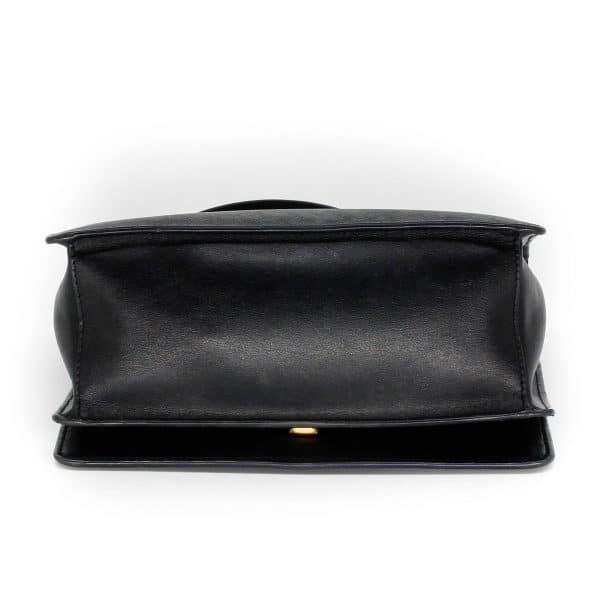 prada flap bag in black with gold chain bottom