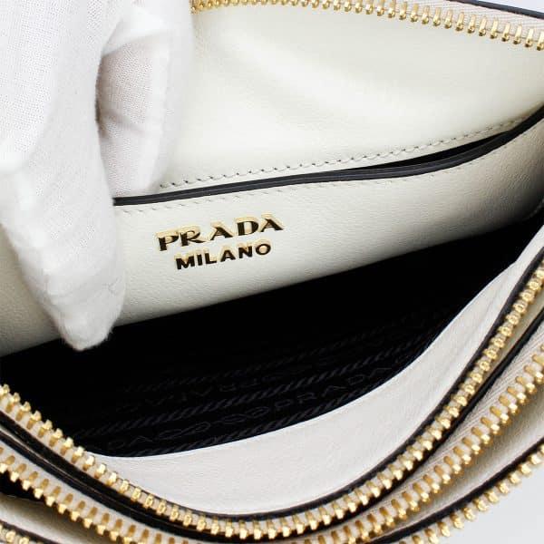 prada double zip white crossbody bag interior