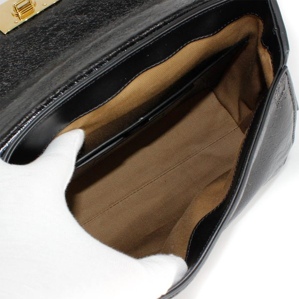givenchy ID bag in aged patent leather with gold hardware interior in tan color with side pocket