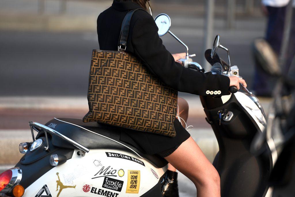 fendi tote bag on girl with motorcycle