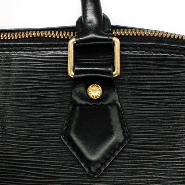 close up of lv alma black epi brass hardware
